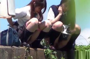Oriental freaky young ladies peeing